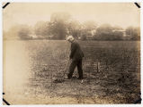 Man (possibly S.B. Christy) turning sod at site of Rutherford Hospital.