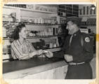 Brig. General Dickinson visits with a clerk at the Officers' Post Exchange