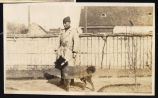 Captain Henry H. George with his war dog, Fritz