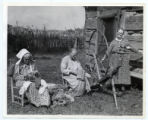 Three mountain women spinning yarn