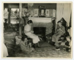 Country family scene near Tullahoma, Coffee County - women sewing covers on baseballs