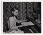 Miss Johnnie Ruth Allred at a loom