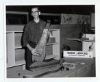 A man displays his handmade dulcimer