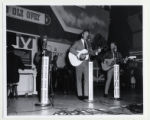 Two Grand Ole Opry performers on stage at the Ryman