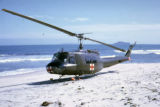Huey medical helicopter a South China Sea beach