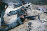 Soldiers at firing range test firing M-60 machine gun