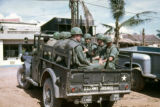 Truck carries soldiers through the streets of Qui Nhon