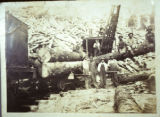Men with logs and Stearns Railroad train