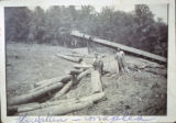 Olen Lewallen and Bige Maples with logs