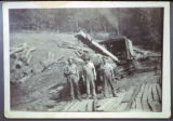 Unidentified loggers in front of flat car