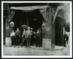 Group of men in front of the Silver Dollar Saloon in the V. E. Schwab Building on Broadway and 2nd...