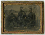 Hand-tinted tintype of Pvt. Milo G. Stone with 2 soldiers eating hardtack