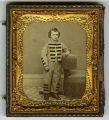 Tintype enclosed in case of young boy wearing typical boys suit