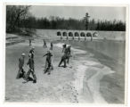 Civilian Conservation Corps workers spreading sand on the beach at the Cumberland Homesteads State...