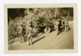 African American Civilian Conservation Corps recruits thinning trees along a freeway