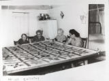 Four women quilting in Hoyt Wakefield's home