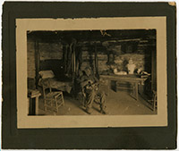 Alfred Jackson sitting in his cabin at the Hermitage