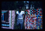 Jewel Allen with two of his quilts